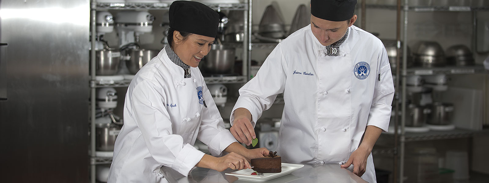 Close-up of pastry chefs preparing a dessert.